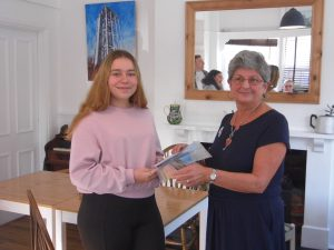 chair SCV presenting prize to runner up in photography competition 2019