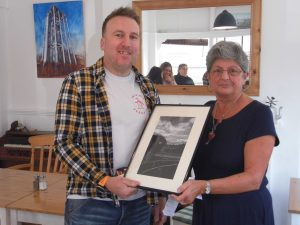 chair of swindon civiv voice presenting photograph to adult winner